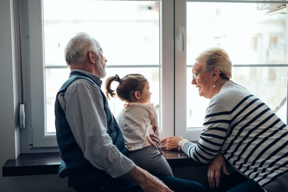 Young girl talking with her grandparentsYoung girl talking with her grandparents   Acadian Hearing