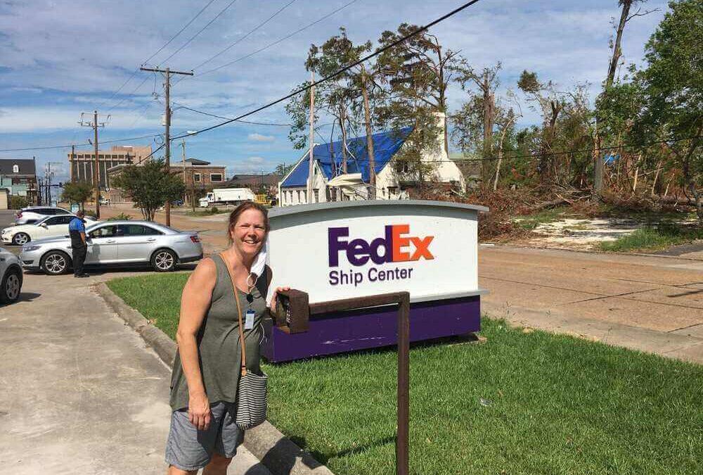 Dr. Bridget Garrido standing outside Acadian Hearing south office